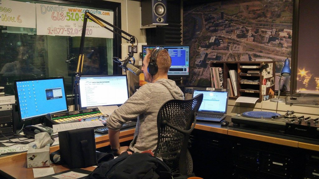 Ryan Bresee sits in the on air studio at CKCU.